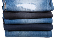 Stack of Folded Blue Jeans in Various Styles Stock Photos
