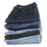 Stack of folded blue jeans on a white background Royalty Free Stock Image
