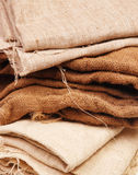 A stack of folded burlap. Textile background. Textile background Royalty Free Stock Image