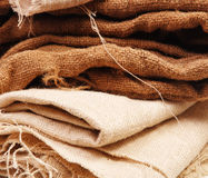 A stack of folded burlap. Textile texture Royalty Free Stock Photo