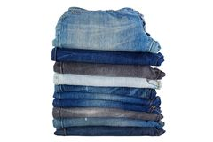 Stack of folded clothes, blue jeans pants, dark blue denim trous Royalty Free Stock Photos