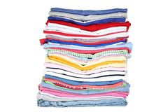 Folded clothes. Stack of folded clothes on white background stock photo