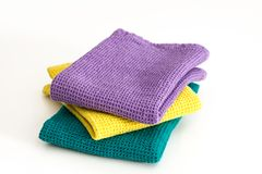 Stack of folded colorful kitchen towels, on white. Stack of  folded colorful kitchen towels, on white background Stock Photography
