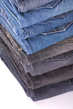 Stack of folded jeans. Over white background stock photography