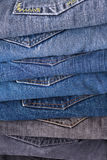 Stack of folded jeans. Close up shooting royalty free stock photo