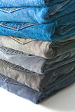 Stack of folded jeans. Over white background stock image