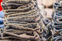 Stack of folded jeans in the store Royalty Free Stock Images