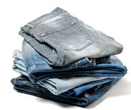 Stack of Folded Old Jeans. Stack of Folded Old Blue Jeans isolated on white background Stock Images