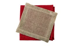Stack of folded red and jute napkins on white royalty free stock photography