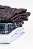Stack of folded shirts Royalty Free Stock Images