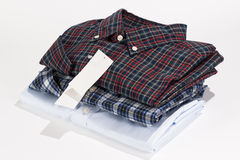Stack of folded shirts Stock Images