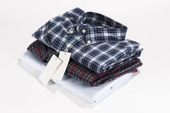Stack of folded shirts Stock Photos
