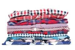 Folded shirts. Stack of folded shirts isolated on white background royalty free stock image