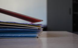 A stack of folders with documents on the table royalty free stock image