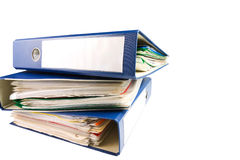 Stack of folders. Pile with old documents and bills. Isolated on white background Stock Images