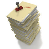 Stack of folders with rubber stamp message of Finished. Stack of manila office folders or files with message of Finished on white background Royalty Free Stock Images