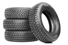 Stack of four car wheel winter tires isolated Stock Image