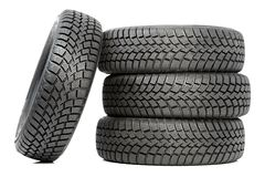 Stack of four car wheel winter tires isolated Royalty Free Stock Photo