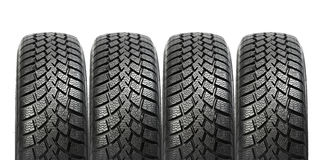 Stack of four car wheel winter tires isolated Royalty Free Stock Photos