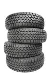 Stack of four car wheel winter tires isolated Stock Images