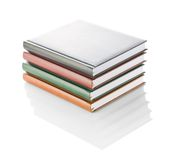 Stack of four diaries isolated Stock Photography