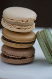 Stack of Four French Macarons. Assorted Colors. Natural Colors and Flavors. A stack of French macarons: vanilla, caramel, chocolate, and pistachio. No stock images