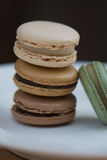 Stack of Four French Macarons. Assorted Colors. Natural Colors and Flavors. A stack of French macarons: vanilla, caramel, chocolate, and pistachio. No stock photos