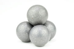 Stack of four lead musket balls on white Royalty Free Stock Images