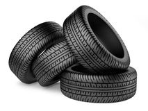 Stack of four new black wheel tyres for car. Isolated on white background 3d image Royalty Free Stock Image