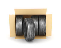 Stack of four new wheels in an open cardboard box Stock Photography