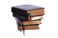Stack of four old books. On white stock photography