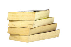 Stack of Four Old Yellowing Paperback Books Stock Photo
