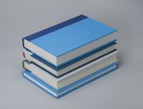 Stack of four plain books for design layout Royalty Free Stock Photos
