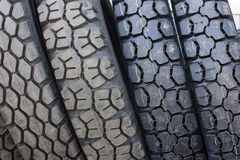 Stack of four unused automobile tires. Datailed close up shot - a stack of four new unused car automobile tires in a row Stock Image