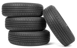 Stack of four wheel new black tyres Royalty Free Stock Image