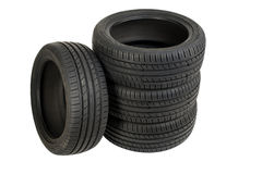Stack of four wheel new black tyres isolated on white Stock Photo