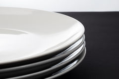 Stack of Four White Shiny Plates Royalty Free Stock Photo