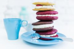 Stack of four whoopie pies or moon pies with cup and spoon. stock photo