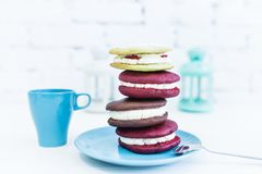 Stack of four whoopie pies or moon pies with cup and spoon. royalty free stock images