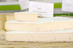 Stack of France Cheese. On the straw royalty free stock photography