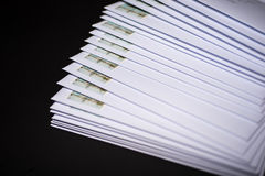 Stack of franked letters in white envelopes on black background.  Royalty Free Stock Image