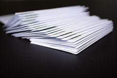 Stack of franked letters in white envelopes on black background.  Stock Photography