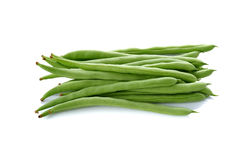 Stack of French beans on white Royalty Free Stock Image