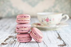 Stack of French Pink Strawberry Macarons. Stack of fresh french pink strawberry macarons on a white rustic table stock photos