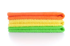 Stack of fresh colorful towels isolated Royalty Free Stock Photo