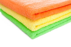Stack of fresh colorful towels isolated Royalty Free Stock Photos