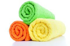 Stack of fresh colorful towels rolls isolated Royalty Free Stock Photography