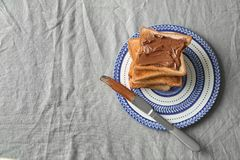 Stack of fresh crispy toasts with chocolate paste Royalty Free Stock Photo