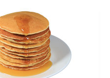 Stack of fresh made pancakes served with maple syrup, with free space for design and text. Stack of fresh made pancakes served with maple syrup, isolated on royalty free stock photo
