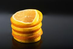A stack of fresh orange and lemon isolated on a black background Stock Images